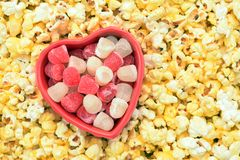 Sweet and gummy Valentine candy. In popcorn background royalty free stock photography