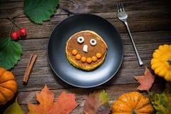 Sweet Halloween food, pumpkin pancakes for kids Stock Image