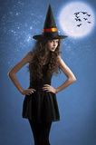 Sweet halloween witch posing under the stars Royalty Free Stock Photos