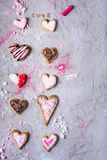 Sweet handmade heart shaped cookies for valentines day on grey cracked surface. Top view of sweet handmade heart shaped cookies for valentines day on grey Stock Photo