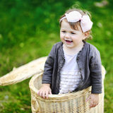 Sweet happy little girl in a park smiling Royalty Free Stock Photos