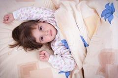 Sweet happy little girl sleeping Royalty Free Stock Image