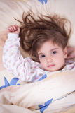 Sweet happy little girl sleeping stock images