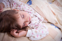 Sweet happy little girl sleeping Royalty Free Stock Images