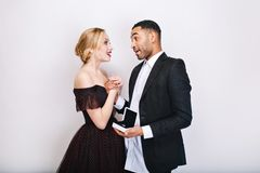 Sweet happy moments of cute couple in love on white background. Proposal of marriage, astonished, ring, present stock image