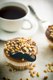 Sweet hazelnut muffin with mustache. royalty free stock photos