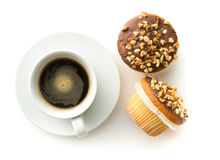 Sweet hazelnut muffins and coffee cup. Stock Photos