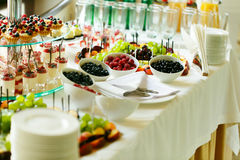Sweet and healthy dessert and fruit table at wedding reception b Royalty Free Stock Photography