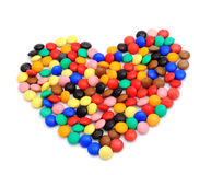 Sweet heart. Color sweets shaped as a heart Stock Image