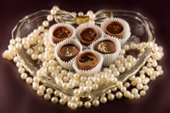 Sweet heart. Picture of chocolate inside heart shaped bowl Royalty Free Stock Images