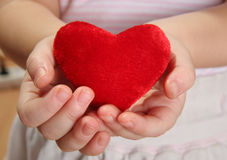 Sweet heart. Red heart in child hands Stock Image