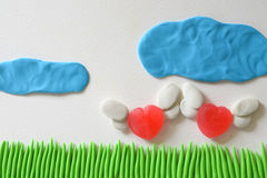 Sweet heart candy angel flying at the field made from plasticine. Stock Images
