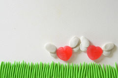 Sweet heart candy angel flying at the field made from plasticine. Royalty Free Stock Photo