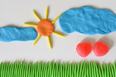 Sweet heart candy angel flying at the field sunshine day made from plasticine. Royalty Free Stock Photo