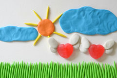 Sweet heart candy angel flying at the field sunshine day made from plasticine. stock photos