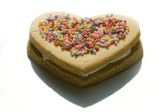 Sweet heart cookie. Cookie with heart shape and a lot of sugar candy on top of it Stock Image