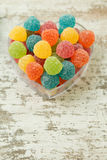 Sweet heart. With jellybeans on a wooden background Royalty Free Stock Photography