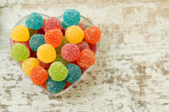 Sweet heart. With jellybeans on a wooden background Stock Photo