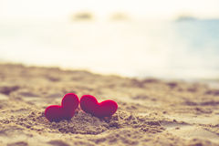 Sweet heart on sand beach under sunset and warm light. abstract background love summer on the beach. vintage color. Tone stock image
