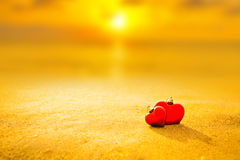Sweet heart on sand beach under sunset and warm light Stock Image