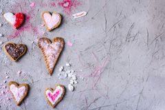Sweet heart shaped cookies for valentines day on grey cracked surface. Top view of sweet heart shaped cookies for valentines day on grey cracked surface Royalty Free Stock Image