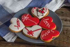 Sweet heart shaped cookies Valentines day on a plate, blue napki Royalty Free Stock Photos