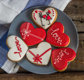 Sweet heart shaped cookies Valentines day on a plate, blue napki Stock Photography