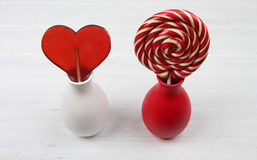 Sweet heart and spiral lollipops in vases Stock Images