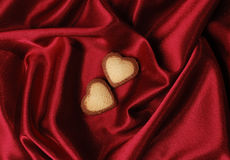 Sweet Hearts on Red Silk Stock Photos
