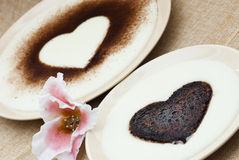 Sweet hearts in semolina pudding with flower of sugar Stock Images