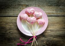 Sweet hearts on sticks on Valentine's Day Royalty Free Stock Images