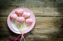 Sweet hearts on sticks on Valentine's Day Stock Photo