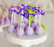 Sweet holiday buffet with cake-pops on sticks. Delicious sweet cake-pops with silk ribbons Stock Image