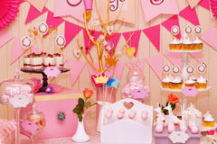 Sweet holiday buffet with cupcakes and meringues Royalty Free Stock Photos
