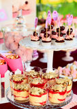 Sweet holiday buffet with cupcakes and tiramisu. Delicious sweet buffet with cupcakes, tiramisu glasses and other desserts Royalty Free Stock Photo