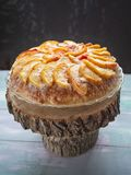 Sweet holiday cake with peaches and cream stock images