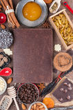 Sweet holiday recipes. Cover of the book to write prescriptions surrounded ingredients for a sweet holiday baking Stock Photos