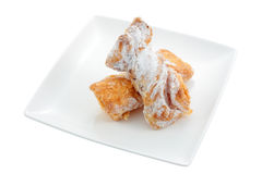 Sweet holy bone. Dish of candy made with puff pastry and sugar cream fillings called bones of saints cut off and isolated Royalty Free Stock Image