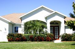 Sweet Home. Attractive white home with gabled roof Stock Photos