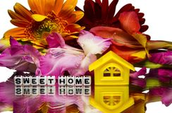 Sweet home with flowers. Sweet home message with flowers and house royalty free stock image