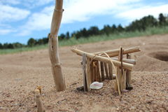 Sweet home. Handmade house on rusiian beach Royalty Free Stock Image