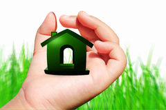 Sweet home icon on hand Stock Images