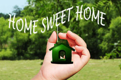 Sweet home icon on hand Stock Photos