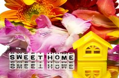 Sweet home. Message with flowers stock photo