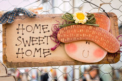 Sweet home wooden decoration hanged on wire mesh Stock Images