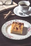 Sweet homemade apple cake and coffee. Breakfast and reading on rustic wooden table.  Royalty Free Stock Photography