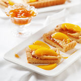 Sweet homemade cake with apricot jam Stock Images