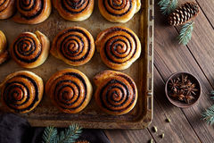 Sweet Homemade christmas baking. Cinnamon rolls buns with cocoa filling. Kanelbulle swedish dessert. Cinnabon roll bread, homemade bakery Royalty Free Stock Photos