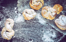 Sweet homemade cinnamon buns sprinkled with powdered sugar Stock Photos