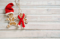Sweet homemade cookies in funny Santa hat for Christmas on white Royalty Free Stock Image